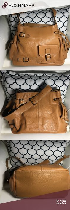 """MAXX NEW YORK London Tan Leather Hobo Bag MAXX NEW YORK London Tan Leather Hobo Shoulder Bag Satchel Handbag 10""""x13""""x6""""Material and Color: London Tan Pebbled Leather Style Type: Shoulder Bag / Satchel Size: Large Handle Type: Single 1.5"""" wide Buckle Adjustable Strap Closure: Inside Top Tab with Magnetic Snap   Exterior: Three Flap Pouch Pockets with Magnetic Snap closures. Strap detail on front & back.    Interior: Zip Pocket, Two Multi-function Pockets, Two Pen Holders + Interior center zip…"""