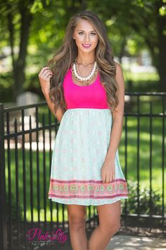 This gorgeous dress is the perfect combination of comfortable and vibrant for the season!