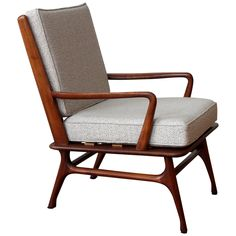 Walnut Lounge Chair    From a unique collection of antique and modern lounge chairs at https://www.1stdibs.com/furniture/seating/lounge-chairs/
