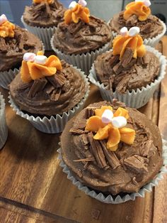 Roasting marshmallows! Chocolate sponge with a chocolate icing topped with chocolate flake as logs, orange royal icing as fire and mini marshmallows roasting!! Perfect for bonfire night!