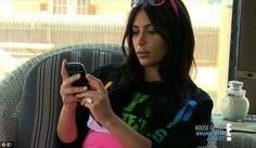 Double checking: Kim took Jonathan's phone to check his e-mail account for any suspicious messages