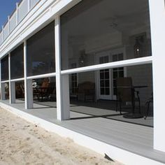 phantoms retractable motorized screens offer shelter from bugs and sun at this new jersey beachfront home