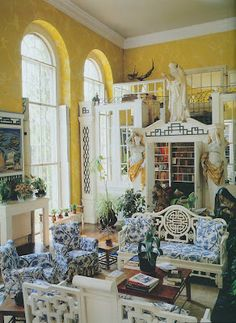 I love this bright yellow wall treatment with all of the white Asian furniture