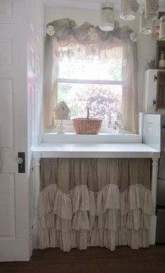 Ruffled & layered vanity cabinet curtain... a soft look for any bath.