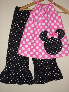 Minnie Mouse pink  polka dot swing top and ruffled pants (available in sizes   5 or 6 ). $34.95, via Etsy.