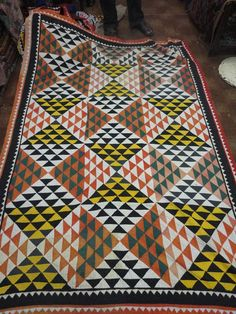A vintage patchwork rallli quilt. send email to mvalasai@yahoo.com for more details.