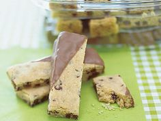 Chocolate-Dipped Shortbread Fingers | Anything tastes good covered in chocolate, right? This collection of awesome chocolate-dipped confections is enough to satisfy anyone's chocolate craving. These treats easily become great food gifts to bring to neighbors, parties, and teachers. Elevate the great flavors of fruits like strawberries and apricots or simple snacks like pretzel sticks and cookies by simply dipping them in chocolate.