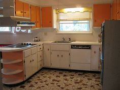 1960s-kitchen - orange and starburst laminate on cabinets! I would have done opposite, orange on bottom starburst on top but still find it very fun!