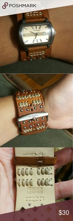 Leather Fossil watch Gently used, received years ago but rarely worn. Genuine leather, thick band. Fossil Jewelry