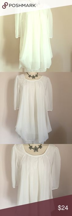 """Dreamy Angelic White Chiffon Long Tunic L XL Dress Dreamy white Chiffon Tunic with double layer design. Tunic has a slip underneath and can be worn as a dress or with leggings underneath. It has a rounded neckline, and long sleeves. NWT and never worn. Tagged an XL but can also fit a large. Measures 42"""" across the chest, 48"""" across, and length from shoulder to hem is 32"""". Material is polyester. boutique Tops Tunics"""
