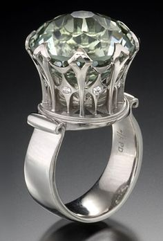 Tourmaline accented by diamonds. Wear it while sipping tea with the queen. At Krikawa Jewelry Designs.