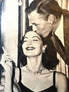 Ava Gardner getting a kiss from Frank Sinatra