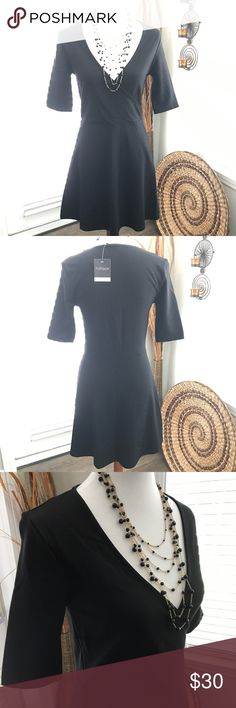 TOPSHOP Little Black Dress NWT Perfect LBD for a casual day or night on the town. Plunging neckline can be toned down with a tank worn underneath or with nothing! New with tags - never been worn. Topshop Dresses