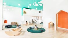 House-shaped openings and cheerful hues are found in a New York daycare centre designed by American firms BAAO and 4|MATIV. The Mi Casita Preschool and Cultural Center is located within a new mixed-use development in the Bedford-Stuyvesant neighbourhood. The 3,500-square-foot (325-square-metre) space was designed collaboratively by local firms BAAO and 4|MATIV. Brooklyn, Maple Floors, New York, Architecture Office, Cultural Architecture, Landscape Architecture, Cultural Center, Coworking Space, Large Homes