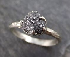 Hey, I found this really awesome Etsy listing at https://www.etsy.com/listing/453680506/rough-raw-black-diamond-engagement-ring
