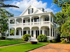 southern home with wrap around white porch. I could imagine myself sitting out on the upper porch at night, listening to the night sounds in the summer time.