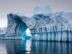 Striped icebergs are quite rare and absolutely gorgeous. These pictures were taken during an expedition to Antarctica.  Blue stripes are formed when water is trapped between ice and it freezes too quickly for air bubbles to form, which causes blue coloration. Other colors appear because of algae and other materials.