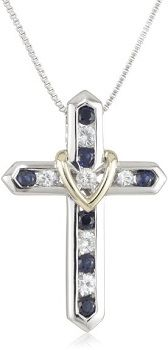 "White and Blue Sapphire ""Cross Your Heart"" Pendant Necklace. The blue and white sapphires are set within a sterling silver cross and has a 14k yellow gold heart set at the intersection of the gemstones."