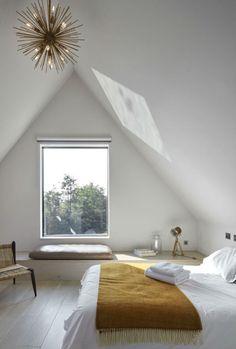 Light attic bedroom in an English summer home