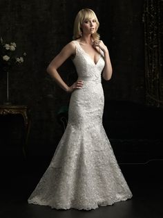 Allure Bridals STYLE: 8973 This lace gown is absolutely stunning. The v-neckline is flattering as Venice lace adorns the entire fitted silhouette. A crystal, floral embellishment accents the waist.  D'Anelli
