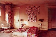 One of the bedrooms at Grey Gardens, showing pink, white, and gold color choices and rose patterns that suggest Little Edie may have had a hand in the decoration. #styleicon #modcloth