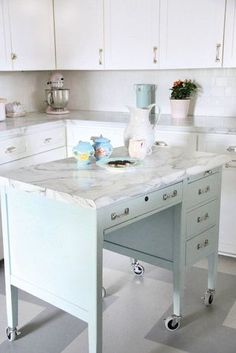 What? Turn a desk into a kitchen island with beautiful marble top and hardware. Brilliant!