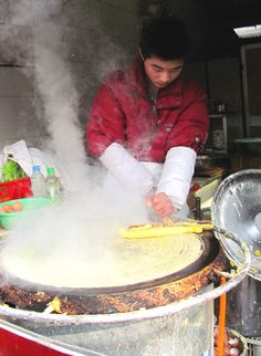The people of Beijing are hardy stock–everyone perfectly dressed and coifed despite the frigid temperatures, a street life, food vendors included, that is not hampered by the dry cold that froze me immediately. Needless to say, one of the best cures for a half-frostbitten fingers is to hold something warm, something comforting, something delicious, between my hands. To heat my belly with the fire of spicy, delicious food fresh from the nearest bundled up cook on the sidewalk.