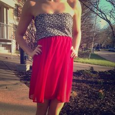 Red dress Silky on the red part, black design with some gold specks on the top part, like new! Dresses
