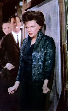 teal jacked with indigo sheath dress and sequins.  movie I could go on singing - Google Search