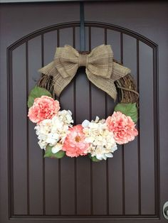 Spring door wreath. DIY Door Wreath. So easy to make! Only took me about 35 minutes with two toddlers running around and only cost about $20 for supplies.