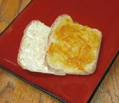 Orange marmalade and butter on some Toasty Muffin Bread slices.