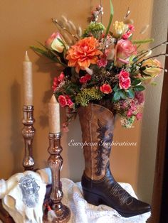 Cowboy boot silk floral arrangement a beautiful centerpiece for a country wedding theme, shabby chic, or southwestern decor