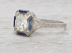 so meeeee  http://erstwhilejewelry.com/collections/art-deco-engagement-rings/products/1-17-carat-art-deco-diamond-sapphire-engagement-ring