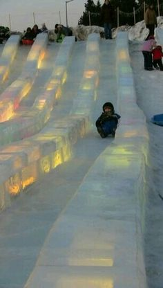 Ice slides at the Ice Park in Fairbanks. Each year people come from all over the world to compete in the Ice Art Championships (ice carvings). They're amazing but what is also fun is what is created for the kids - an ice rink, ice slides, spinning ice cup Moving To Alaska, North To Alaska, Alaska Travel, Alaska Trip, Alaska Usa, Visit Alaska, Alaska Cruise, Dream Vacations, Vacation Spots