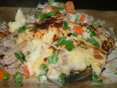 Shepherd's Pie..Turkey, Onions, Garlic, Carrot, Peas, Chili Flakes, Stock,  Potatoes  with Parmesan, Blue, Cheddar, and Romano .