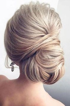 Classic Chignon - Swoon-worthy Summer Wedding Hairstyles - Southernliving. Sleek and chic, this classic hairdo proves that traditional definitely doesn't mean boring.
