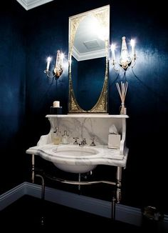 Just thinking about how to do formal powder room.  backsplash,...and love how the backsplash comes down on the sides too!  its a bit too high though...I wouldnt be able to see into the mirror...thinking...dont take the backsplash in with that curve, bc you need to keep the width for the weight of the mirror....