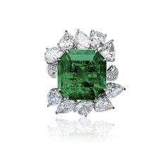 A 15.92 CARAT EMERALD AND DIAMOND RING. Set with a square emerald-cut emerald weighing 15.92 carats, surrounded by pear-shaped diamonds altogether weighing approximately 7.44 carats, mounted in platinum, ring size 5 1/2. ESTIMATE USD 643,000 - 771,600 // SOLD PRICE USD 1,062,236. AGL / the emerald is of Colombia origin, with no indications of clarity enhancement [POLY Auction HK - 3 April 2017] #PolyAuction #Emerald #NoTreatment