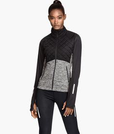 Black & gray lightweight fitted running jacket with fast-drying thermal fleece, reflective details, and thumbhole cuffs.   H&M Sport
