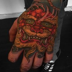 Did this little job stopper shishi today. #tattoo #tattoos #handtattoo #tatts #foodog #shishi #colour #colourtattoo #boldtattoo #orientaltattoo #art #artist #design #ink #inked #illustration #matthart #inspirationstattoos #uk by inspirationstattoos https://instagram.com/p/3O_vqehi2v/: