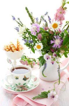 Cute teacup and saucer...love the flower arrangement as well