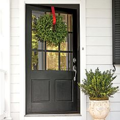 Oversize Front Door - Charming Virginia Farmhouse |  The door's width is greater than usual—42 inches as opposed to 36 inches—to give it more weight and importance. The glass panes invite the outdoors in