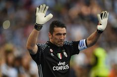 """Juventus' goalkeeper from Italy Gianluigi Buffon celebrates after winning the Italian Serie A football match Juventus vs Crotone and the """"Scudetto"""" at the Juventus Stadium in Turin on May 21, 2017. First-half goals from Mario Mandzukic and Paulo Dybala, and a late header from Alex Sandro sealed a 3-0 win over Crotone to hand Juventus a record sixth consecutive Serie A title today. / AFP PHOTO / Filippo MONTEFORTE"""