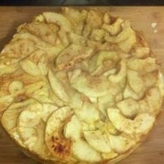 Apples with cinnamon and sugar top a cream cheese filling in a springform pan to make an appealing dessert perfect for any occasion.