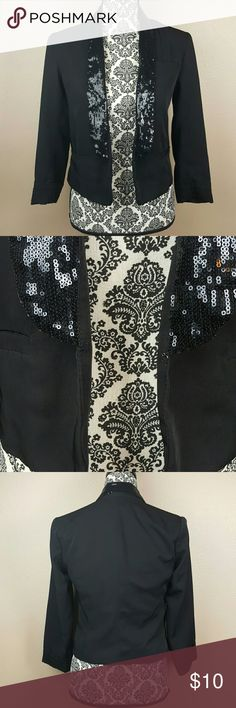 FOREVER 21 Black Bling Sequins Blazer A super cute bling sequins black blazer by Forever 21. The closing clasp is missing but I always wore it open so it didn't bother me. The inside is a bit torn in some areas but not noticieable while wearing. This fun blazer is great to take to work! Forever 21 Jackets & Coats Blazers