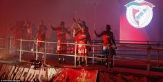 Benfica players celebrate the club's 34th Portuguese title in downtown Lisbon on Sunday evening with their fans