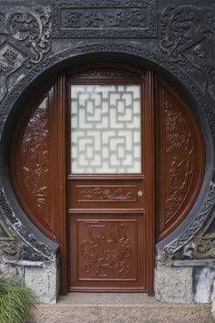 Picture of Circular frame around a wooden door in Yuyuan Garden - China - Asia