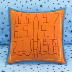rocket ship pillow, for C. Wonder if it matches the orange blanket or not?
