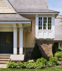 """The owners' favorite feature in the Kenwood Shingle Style Cottage is a unique and intriguing bay on the stair landing which provides a view down the street and an architectural """"moment"""" from without as well as within. Stair Landing, Cottage Style, Garage Doors, New Homes, Stairs, Exterior, In This Moment, Architects, Outdoor Decor"""