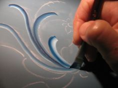 Tutorial on freehand Telemark Rosemaling design.